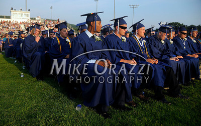 6/20/2012 Mike Orazzi | Staff Plainville High School graduates during the graduation ceremony on Wednesday night at Alumni Field.