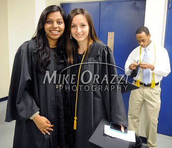 5/18/2013 Mike Orazzi | Staff Central Connecticut State University graduates Anne Marie Moni and Aleksandra Lis at the XL Center in Hartford on Saturday.