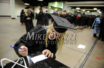 5/18/2013 Mike Orazzi | Staff Central Connecticut State University graduate Tracy Anderson fills out her name tag at the XL Center in Hartford on Saturday.