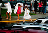 6/25/2013 Mike Orazzi | Staff<br /> Bristol Central High School graduates use their gowns to stay during a downpour just before the start of Tuesday night's commencement exercise in Bristol.