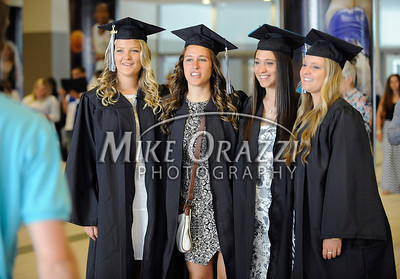 5/17/2014 Mike Orazzi | Staff CCSU students line up for a group photo during Saturday's graduation ceremony at the XL Center in Hartford.