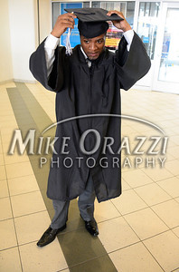 5/17/2014 Mike Orazzi | Staff CCSU student Thomas Stewart adjusts his cap during Saturday's graduation ceremony at the XL Center in Hartford.
