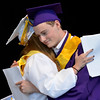 MIKE McMAHON - MMcMAHON@DIGITALFIRSTMEDIA.COM, Lauren Bell hugs her twin brother Matthew Bell the Salutatorian at the Ballston Spa High School commencement at the Saratoga Performing Arts Center, Wedesday June 24, 2015
