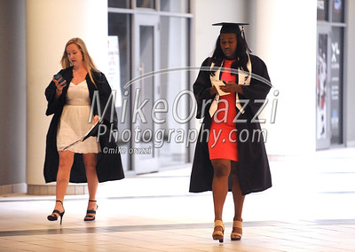 5/20/2017 Mike Orazzi | Staff Chayla Lewis (right) arrives at the the XL Center in Hartford for CCSU's graduation Saturday morning.