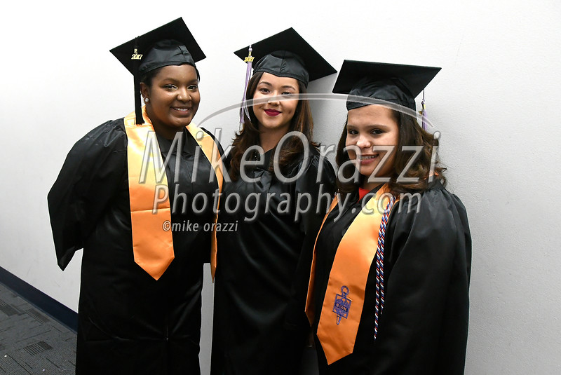 5/25/2017 Mike Orazzi | Staff<br /> Tunxis Community College graduates Tiara James, Neshlie Gonzalez and Sharri Mendez at the Forty-sixth Commencement Thursday evening in Farmington.