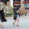 5/20/2017 Mike Orazzi   Staff<br /> Olivia McDonald and Katherine Diehl hold their caps as the run across a windy Trumbull Street toward the XL Center in Hartford for CCSU's graduation Saturday morning.