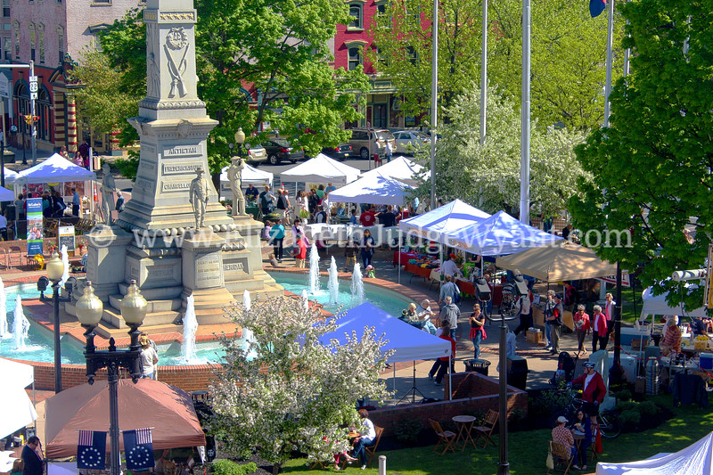 """Easton Farmers' Market, Centre Square in Spring, Easton, PA The Great Square has been the site of the oldest, continuously operated outdoor Farmers Market since 1792. The Civil War Monument that now stands in the square is a 75 foot tall obelisk topped by """"The Bugler."""" Formally named the Soldiers' & Sailors' Monument was dedicated to local veterans in 1900."""