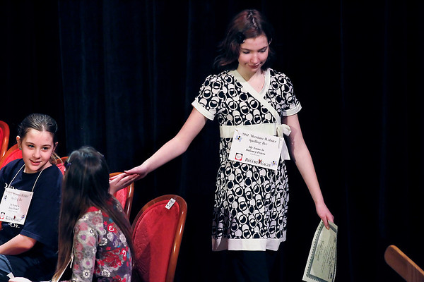 Record-Eagle/Jan-Michael Stump<br /> Delaney Peters gets a high-five from Lydia Christian after being knocked out of the 2011 Grand Traverse Regional Spelling Bee Sunday at the City Opera House.