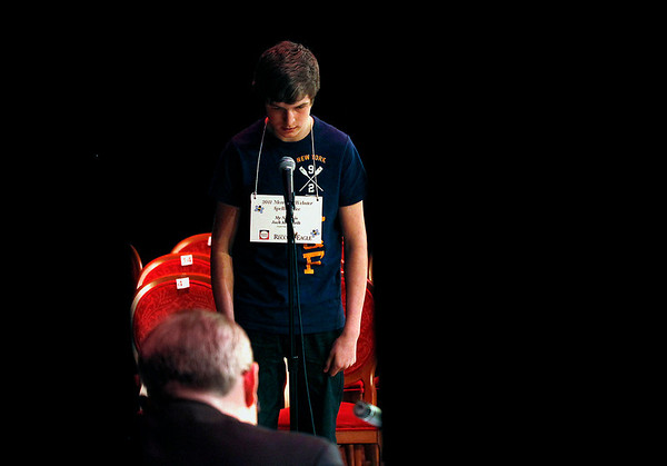 Record-Eagle/Jan-Michael Stump<br /> Jack Krcmarik spells a word in one of the last rounds of the 2011 Grand Traverse Regional Spelling Bee Sunday at the City Opera House. Krcmarik finished second.