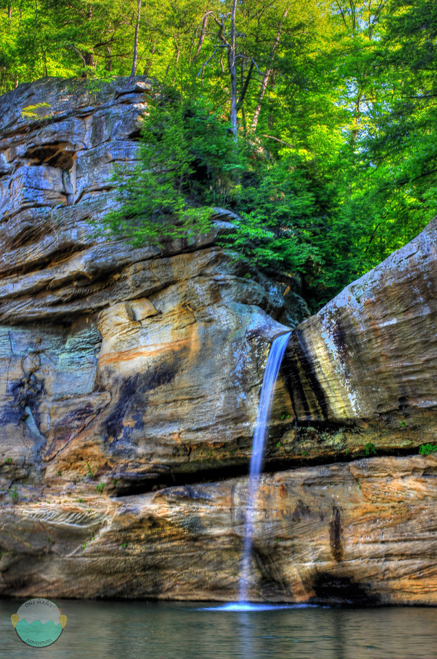 This falls was on my Sunday 11 mile paddle.  It goes through a sweet looking gorge of its own before empting out into a huge gorge that has cliffs the size of the left side of the falls all the way around on 3 sides.  Lick Falls measures at about 26' tall and shoots out off the cliff.  It it the single falls on/near Grayson Lake that I have found a previous name for.  Lick Creek is the water source for this falls.  It is located in teh State Park and there is a 3 mile hike to get to it, but I find it about impossible that you could view the falls from any cliffs nearby.  Only the water.