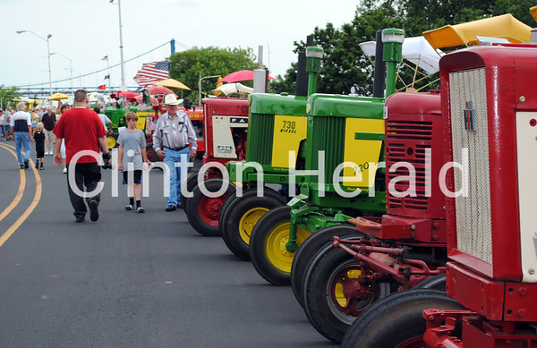 Viewers admire the 500 unique tractors that rolled into Clinton on June 11 as part of the Great Eastern Iowa Tractorcade. • Natalie Conrad/Clinton Herald