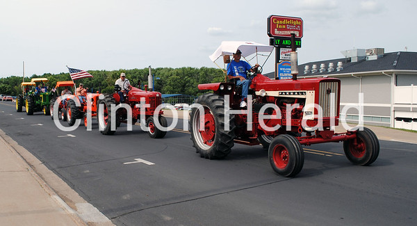 Tractors parade down Riverview Drive on June 11 as part of the Great Eastern Iowa Tractorcade. • Natalie Conrad/Clinton Herald