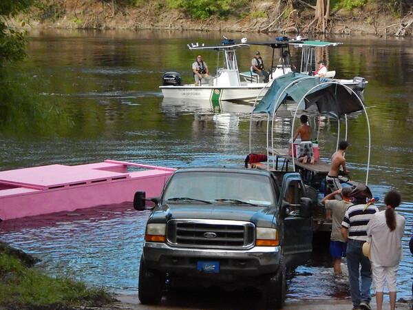 Alcorn crew launching their raft.