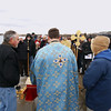 Record-Eagle/Keith King<br /> Attendees gather on the Clinch Park Marina pier Saturday, January 7, 2012 for the Great Blessing of the Waters presided by Father Ciprian Streza, middle, of the Archangel Gabriel Greek Orthodox Church of Traverse City, as Steve Bemis, left, stands near.