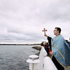Record-Eagle/Keith King<br /> Father Ciprian Streza of the Archangel Gabriel Greek Orthodox Church in Traverse City prepares to toss a cross into West Grand Traverse Bay Saturday, January 7, 2012 during the Great Blessing of the Waters on the Clinch Park Marina pier.