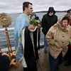 Record-Eagle/Keith King<br /> Donna Fickling, of South Boardman, walks away after being blessed with holy water on the Clinch Park Marina pier by Father Ciprian Streza of the Archangel Gabriel Greek Orthodox Church in Traverse City Saturday, January 7, 2012 during the Great Blessing of the Waters.