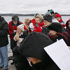 Record-Eagle/Keith King<br /> Attendees gather on the Clinch Park Marina pier Saturday, January 7, 2012 for the Great Blessing of the Waters held by the Archangel Gabriel Greek Orthodox Church of Traverse City.