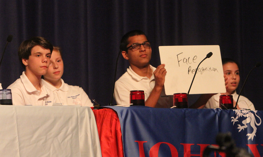 . Greater Lowell Regional Knowledge Bowl finals at Tyngsborough High School. Tewksbury Wynn Middle School team members, from left, Peter Impink, Sarah Johansen, Harshit Pal and Morgan Crowley, correctly answer a question in the Current Events round. (SUN/Julia Malakie)