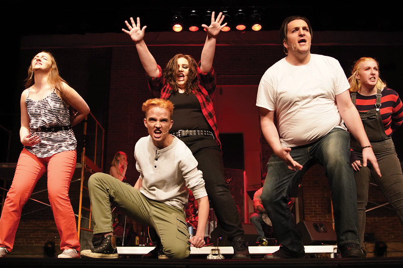 "Matthew Gaston | The Sheridan Press<br>Sheridan College students, from left, Nicolette Krumberger, Marcel Bohlmann, Brooklyn Nowack, Levi-Lucas Shumaker and Victoria Waterhouse belt out the opening number for Sheridan College's production of ""Green Day's American Idiot"" during the dress rehearsal at the WYO Performing Arts and Education Center Tuesday, Nov. 12, 2019."