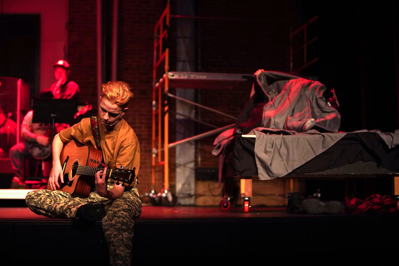 "Matthew Gaston | The Sheridan Press<br>Marcel Bohlmann as Tunny adapts to life in the army while his old friend Johnny takes a tumble with Whatsername during the dress rehearsal for ""Green Day's American Idiot"" Tuesday, Nov. 12, 2019."