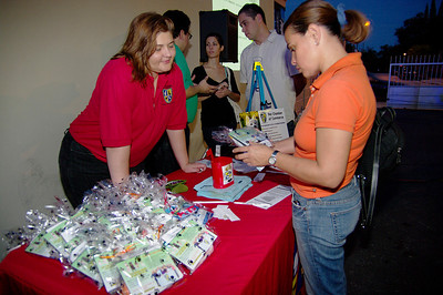 1/30/10—Monica Rimada tells Luz Villamizar about what are inside the pet chamber goodie bags during the Environmental Green Dog party in Miami.