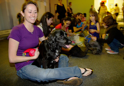 1/30/10—Tara Gaetjens, 30, from Kendall holds Molly as they relax and listen to a green dog presentation during the Environmental Green Dog party in Miami.