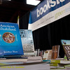 Books and bookstore sign. Green Festival 2010, Concourse Exhibition Center, 635 8th St. (at Brannan), San Francisco, California.