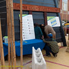 Green Home & Energy Pavilion exterior with people crouching. Green Festival 2010, Concourse Exhibition Center, 635 8th St. (at Brannan), San Francisco, California.