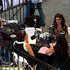 Rose Aguilar and Malihe Razazan interviewing unidentified guest during KALW live broadcast. Green Festival 2010, Concourse Exhibition Center, 635 8th St. (at Brannan), San Francisco, California.