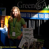 Green America booth worker with banner. Green Festival 2010, Concourse Exhibition Center, 635 8th St. (at Brannan), San Francisco, California.