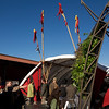 Green Building Pavilion with flags, windmill and hydroponics. San Francisco Green Festival 2009, Concourse Exhibition Center, 635-8th St., San Francisco, California.