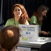 Green America and Global Exchange registration desk worker. San Francisco Green Festival 2009, Concourse Exhibition Center, 635-8th St., San Francisco, California.