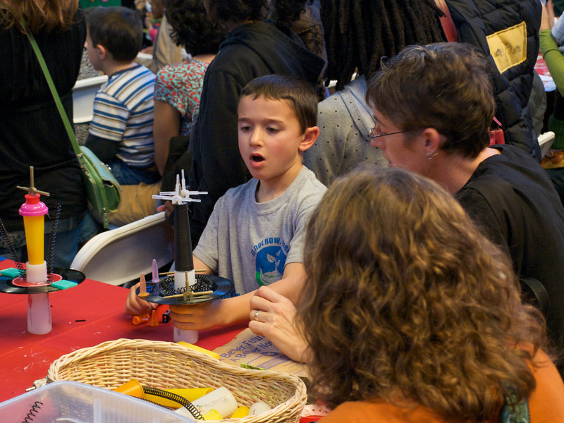 Child building sculpture in Organic Valley Kids' Zone. San Francisco Green Festival 2009, Concourse Exhibition Center, 635-8th St., San Francisco, California.