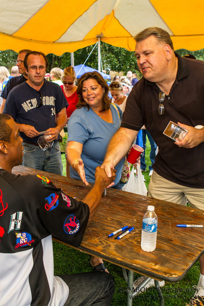 """Dwight """"Doc"""" Gooden signs some autographs at the Greenwich Township Community Day 2012."""