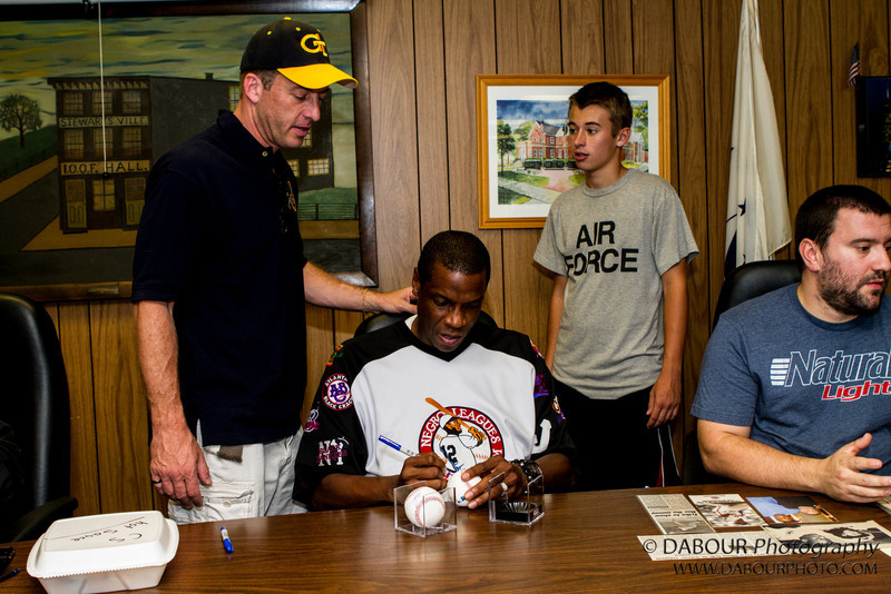 """Greenwich Twp. Committeeman Tom Callari and his son TJ visit with Dwight """"Doc"""" Gooden, former NY Yankee and Mets  at the Greenwich Township Community Day 2012. Express-Times Photo by 