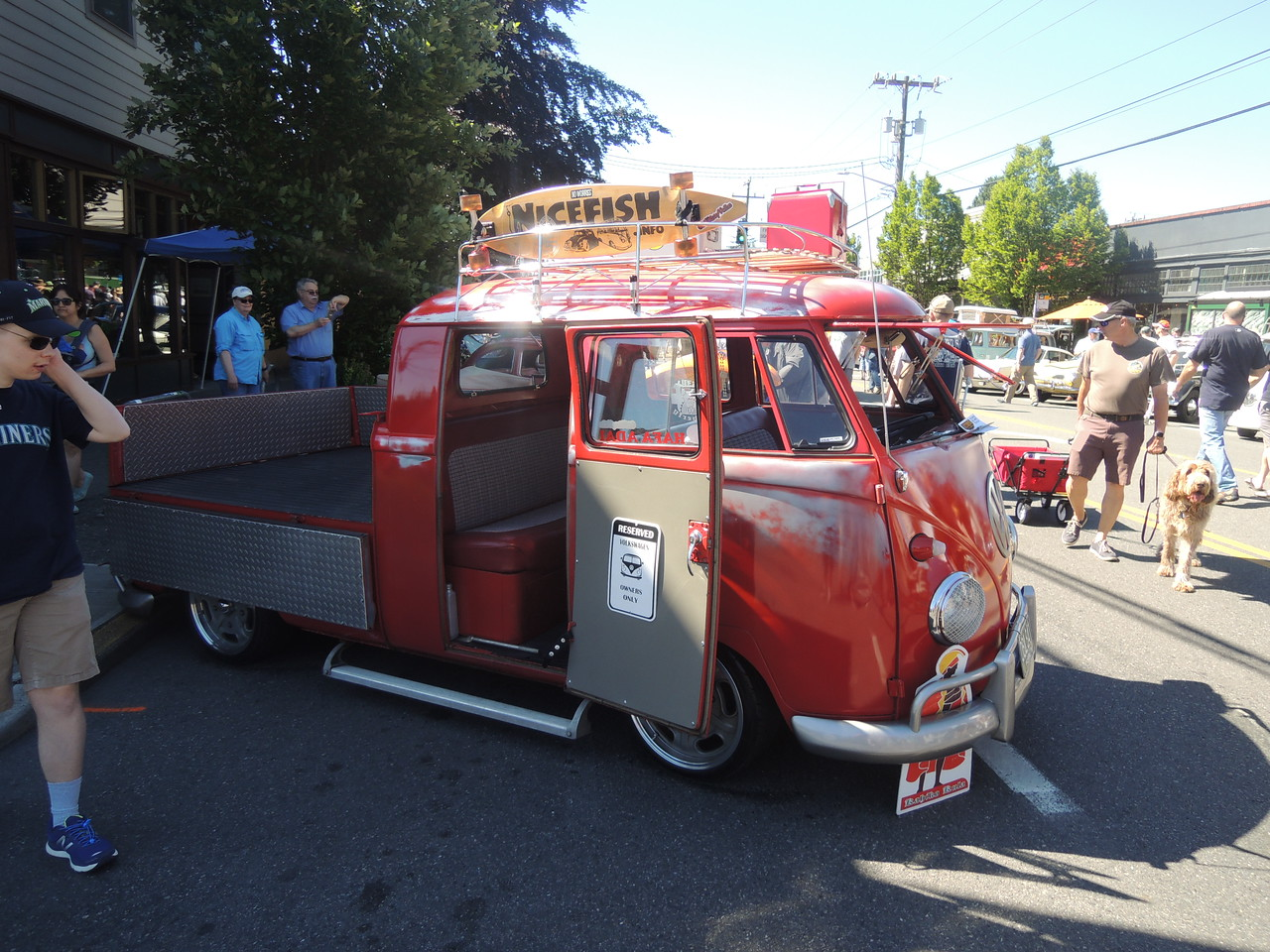About a 1960 VW Combi with crew cab and drop sides on the bed.  Very cool!  You could travel far, very slowly, in this rig.