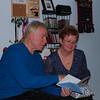 Greg & Jenny reading an anniversary card.