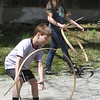 Groton Womens Club holds Back in Time event at the Williams Barn, to show life in the 1700s in the community. Alyssa Peeters, 14, and her brother Alex Peeters, 8, of Groton, play with hoops and sticks. (SUN/Julia Malakie)