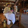 Groton Womens Club holds Back in Time event at the Williams Barn, to show life in the 1700s in the community. Groton Womens Club member Bonnie Carter of Groton spins mohair from Angora goats. (SUN/Julia Malakie)