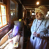 Groton Womens Club holds Back in Time event at the Williams Barn, to show life in the 1700s in the community. Marie Melican of Groton, president of the Groton Women's Club, who was serving butter she made herself, on crackers she made herself. (SUN/Julia Malakie)