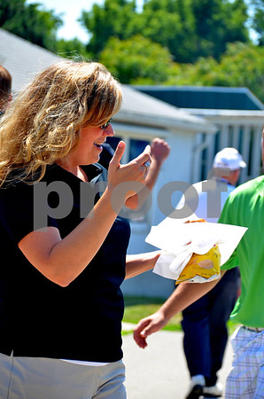-Messenger photo by Britt Kudla<br /> Lisa Shimkat grabs a bite to eat before the Annual Fort Dodge Greater Growth Alliance golf tournament on Thursday at the Fort Dodge Country Club