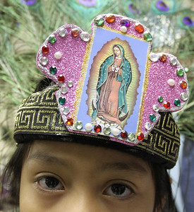Five-year-old Emily Sanchez waits as the other dancers around her get ready for their performance on the feast of Our Lady of Guadalupe, Dec. 12. The age range of the dancers goes from five-years-old up to 48.