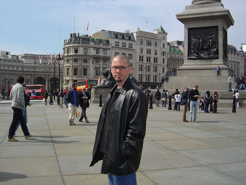 Rob in Trafalgar Square. Notice the double-decker buses behind him.