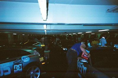 Everyone in the garage in Paris prior to the start packing and making last minute adjustments.