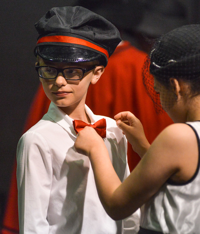 "Justin Sheely | The Sheridan Press<br /> Twelve-year-old Ewan Duncan gets his bowtie straightened by another cast member during a dress rehearsal for ""Guys and Dolls Jr."" at the Wyoming Performing Arts and Education Center Tuesday, June 12, 2018. The Tandem Productions presentation is comprised of young thespians, ages 8-15. The play shows Wednesday through Saturday, June 13 - 16, at 7:30 p.m. Tickets are available at the WYO box office or online at wyotheater.com."