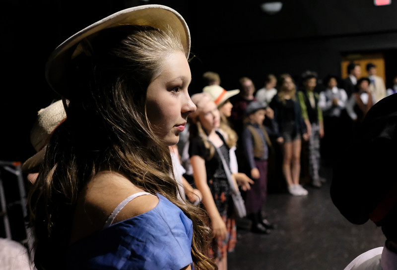 "Justin Sheely | The Sheridan Press<br /> Thirteen-year-old Vivi Ostheimer of Buffalo, Wyoming, looks on as the cast warm up during a dress rehearsal for ""Guys and Dolls Jr."" at the Wyoming Performing Arts and Education Center Tuesday, June 12, 2018. The Tandem Productions presentation is comprised of young thespians, ages 8-15. The play shows Wednesday through Saturday, June 13 - 16, at 7:30 p.m. Tickets are available at the WYO box office or online at wyotheater.com."