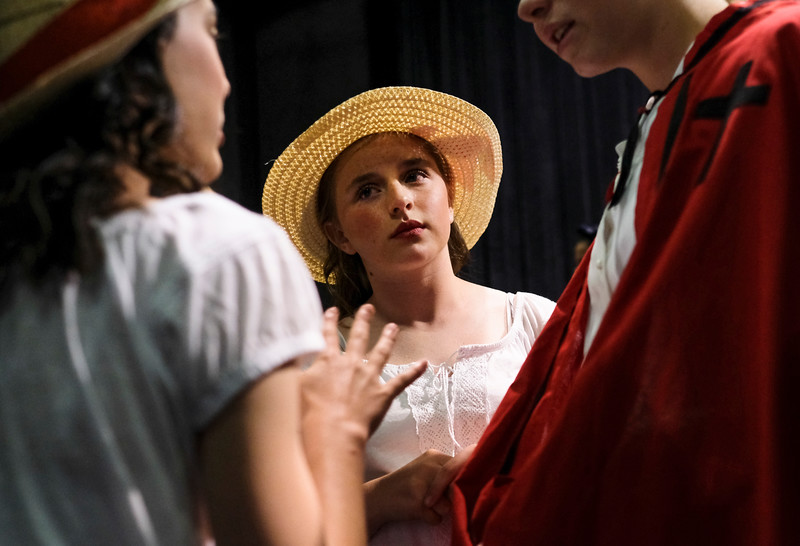 "Justin Sheely | The Sheridan Press<br /> Eleven-year-old Laci Nissen listens to a conversation among actors during a dress rehearsal for ""Guys and Dolls Jr."" at the Wyoming Performing Arts and Education Center Tuesday, June 12, 2018. The Tandem Productions presentation is comprised of young thespians, ages 8-15. The play shows Wednesday through Saturday, June 13 - 16, at 7:30 p.m. Tickets are available at the WYO box office or online at wyotheater.com."