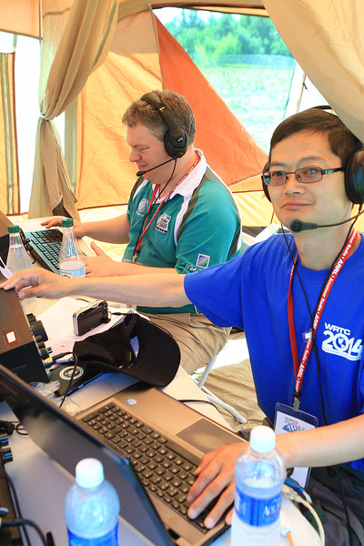 L- R Gerry Lynch from Northern Ireland and Kazu Watanabe from England surf the airways for other amature radio opeators around the globe.<br /> <br /> Photo Scott LaPrade