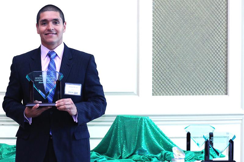 2012 HCAC Brilliance  Awards: Julian Arcila, Executive Director, Hispanic Contractors Association of the Carolinas (HCAC), holding award for General Contractor of the Year Award Winner, AlCorp LLC.