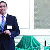 2012 HCAC Brilliance  Awards: Julian Arcila, Executive Director, Hispanic Contractors Association of the Carolinas (HCAC), holding award for General Contractor of the Year Award Winner, AlCorp LLC.